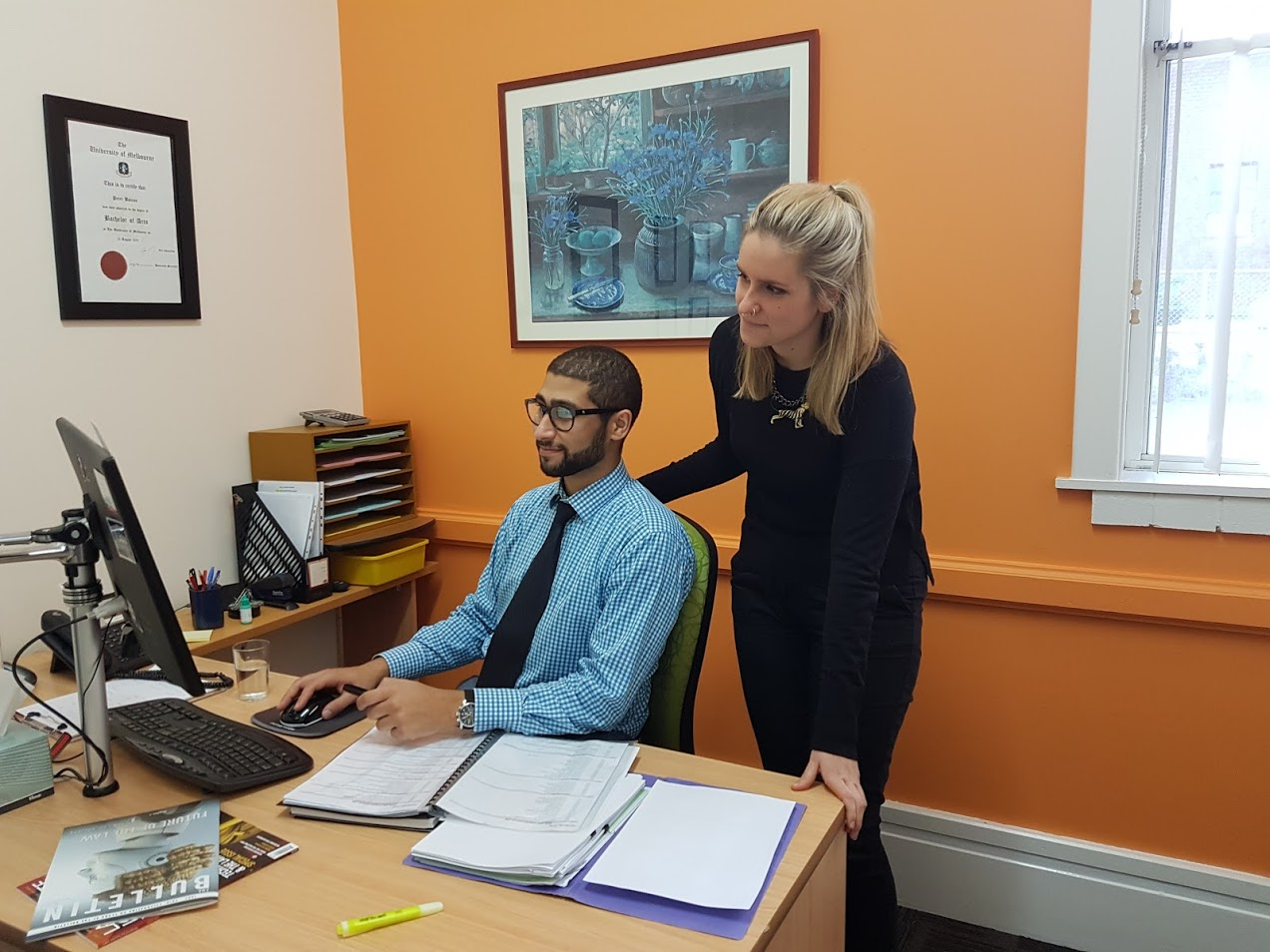 MLS alumni Ms Henson and Mr Peter Botros in their office at South East Community Legal Service