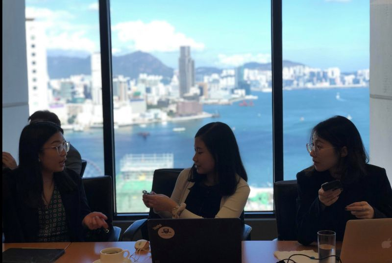 Students discussing Hong Kong's commercial relationship with mainland China, at Skadden Arps' Hong Kong office. Image: supplied.