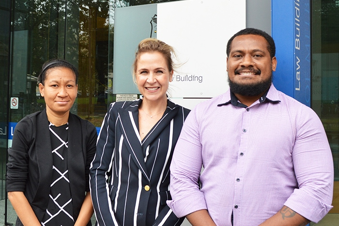 Grace Misina and Emmanuel Auru pictured with Professor Caron Beaton-Wells