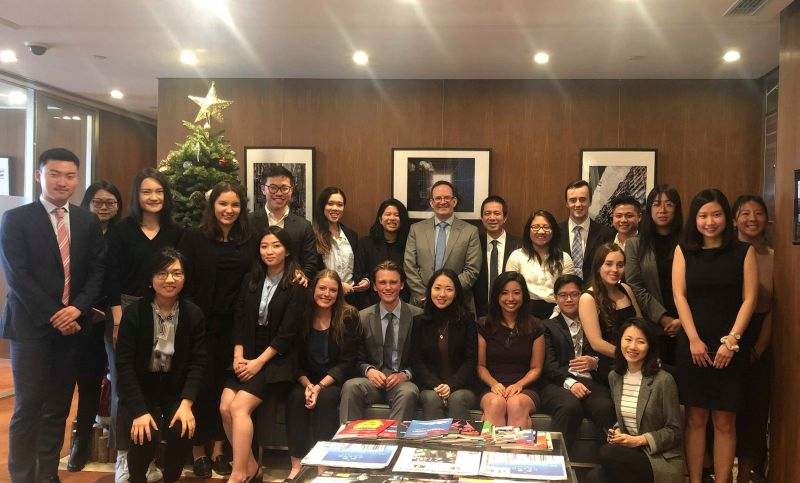 Associate Professor Andrew Godwin, Dr Hop Dang and students at the Ashurst Hong Kong office. Photo: supplied.