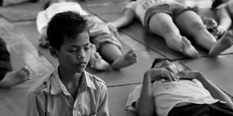 Cambodian youth doing yoga