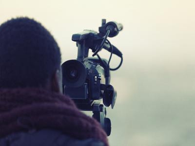 Man using film camera